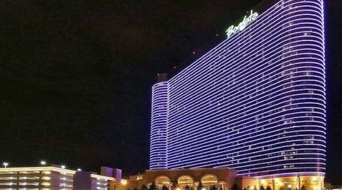 The Borgata Atlantic City Casino glowing in purple to set itself apart from Atlantic City's busy casino venues.