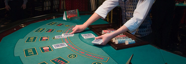 live dealer casino games dealing cards at table